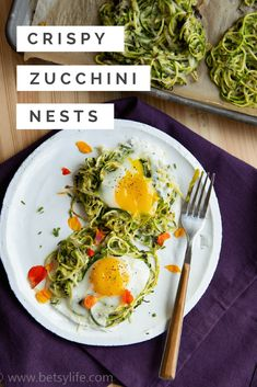 Spiralized zucchini, breadcrumbs, cheese and herbs come together simply to make these crispy nest fritters. The perfect vessel for a runny egg. A great light summer recipe, that comes fresh from your garden. #spiralizedzucchini #zoodles #zucchininoodles #veggienoodles #gardenfresh #vegetarianrecipe #vegetablenoodles #putaneggonit