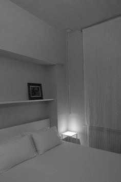 Apartment : Simply Brilliant Apartment In Piacenza Designed by Studio Blesi Subitoni - Simple Apartment Bedroom Corner in The Night with Mini Nightstand and Gray Wall Paint Color and White Bedding Set and Wall Shelf medium version