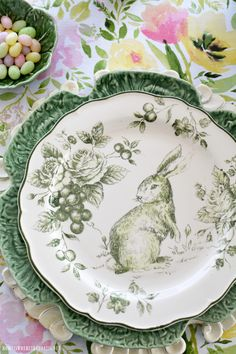 I'm hopping down the bunny trail with a table for Easter, with bunnies, eggs and a spring blooming centerpiece! Green and white toile bunny plates are layered on cabbage leaf plates atop carv…