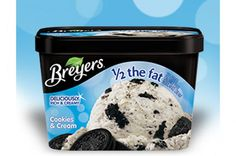 "SELF-Approved Treats | Ice Cream: Breyers 1/2 the Fat Cookies & Cream. One reader said, ""This one doesn't taste healthy at all—I love it!"""
