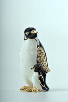 # Penguins Trinket Box by Keren Kopal Faberge Egg Swarovski Crystal Jewelry box - Each item is made of pewter