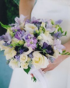 Hand tied bouquet of roses, fressia, stock, sweet peas, miniature calla lilies, lisianthus, lavender & wax flower