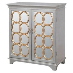 Hall chest in silver and gold with interlocking ring overlaid doors.  Product: Hall chestConstruction Material: ...