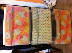 Mod podge scrapbook paper on plastic drawers!