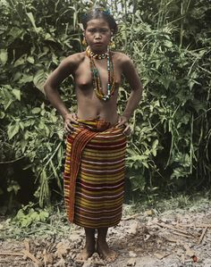 1334798. A Kalinga Igorot woman in traditional clothing poses for a portrait.