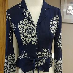 Talbots 100% Pure Silk Shorter Length Blouse Beautiful navy and tan 100% pure silk Talbots blouse. Buttons down front and has a silk navy tie. Size 2. Talbots Tops Blouses