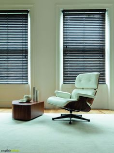 Dark rustic wood blinds, contemporary chair and table.