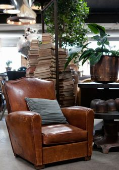 The coziest place to curl up with a good book. We have you covered. Vintage home decor, a leather club chair and stacks of vintage books in our showroom. http://bdantiques.com/