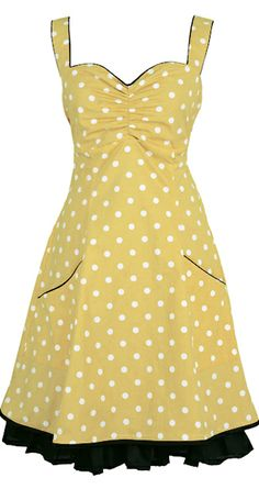 Norah - Yellow. DRESS IN ORGANIC COTTON. The dress is named after the great singer Norah Jones. It is inspired by 50s pinup and Mad Men style, this knee-length dress is made from 100% organic cotton [GOTS-certified] with polka-dots. The elasticated panel at the back and side zipper provide flexibility. The dress has pockets and it is lined with a very comfortable bamboo-silk.