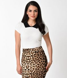 Something new for your pin-up prime, gals! A blissful closet compulsory, this vintage style sweater top is sophisticated and elegant in sultry white cotton knit luxury. A darling black ribbed classic collar accompanies a flexible fit bodice that cinches w