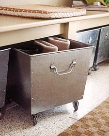These store-bought bins, tall enough to hold a pair of boots upright, were outfitted with casters, then placed beneath a simple wall-mounted half bench in an entryway. Available at hardware stores and home centers, casters are practical additions to all types of storage bins and boxes, particularly those with open tops - extra gear can be placed inside