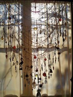 """""""Copper wire found object hanging (curtain). Herons are symbolic of calm and peace for the inner soul. The two horn heron carvings embedded in this curtain evoke images of those regal birds stalking silently through 