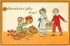 HALLOWE'EN'S A JOLLY TIME!  boy shows Jack-o-Lantern to boy & girl carrying apples