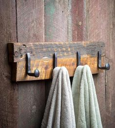 Hang up your hat, coat and satchel too on this rustic rack. The base is built of thick planks of reclaimed wood, and each piece of lumber is marked with hints at its past life. A series of railroad spikes are hand forged into square or twisted hooks, and firmly affixed to the board base. Place it by your front door, to unload your gear after workin' all the livelong day, or in the bathroom to hang up your towels.