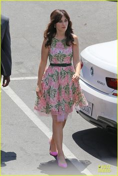Zooey Deschanel is pretty in a pink dress while walking on the set of her hit show New Girl on Monday (August 4) in Los Angeles.