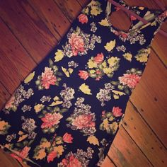 F21 black floral mini dress Forever 21 large. Black with beautiful floral pattern. Stretchy/fitted, mini skirt. Cute now detail on scoop back. Gently worn, got so many compliments! Smoke free pet free home Forever 21 Dresses Mini