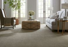 Give your traditional living room a neutral base with our Queensbury Villa Family Friendly Carpet in Delray. This plush carpet patterned texture is fit for royalty. It retails starting at $4.49 SQ FT.