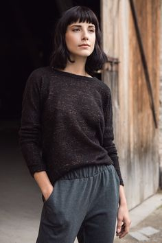 Knit jersey pants & openwork black - gold jumper.