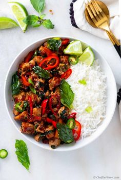 An easy and flavorful Thai Basil Chicken stir-fry recipe which you can prepare in 25 minutes at home. Serve with steamed rice for a homemade Thai dinner quicker than takeout or wait for delivery. Chicken Basil Recipes, Thai Basil Recipes, Asian Recipes, Healthy Recipes, Spicy Thai Basil Chicken Recipe, Healthy Breakfasts, Healthy Snacks, Stir Fry Recipes, Cooking Recipes