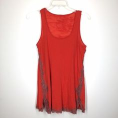 """Free People We the Free red tank size small This red tank is jersey knit. Very thin material, almost sheer. Bust 32"""". Length 27"""". Lace detail on the sides. Very clean! Some slight pilling. Free People Tops Tank Tops"""