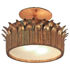 Art Deco Gold Leaf Flush Mount Light | From a unique collection of antique and modern flush mount at http://www.1stdibs.com/furniture/lighting/flush-mount-ceiling-lights/