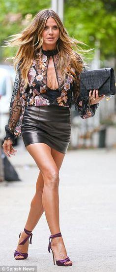 Strutting her stuff: Heidi flaunted her killer legs in some purple satin heels