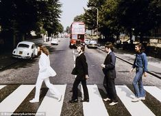 Familiar, yet unfamiliar:Rare photographs of the Beatles crossing Abbey Road shot for the cover of the last album they recorded together have sold for a whopping £180,000