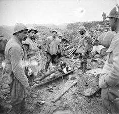 Battle of Verdun: French soldiers bringing in a severely wounded comrade at Fort Douamont, December 1916.