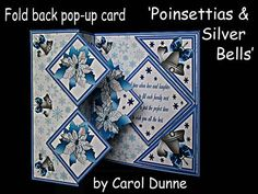 Fold back pop up Poinsettias silver bells on Craftsuprint designed by Carol Dunne - These fold back kits with a pop-up inside are very easy to make. The kits includes easy to follow photographic instructions. This one is decorated with blue poinsettias and silver bells and the verse reads