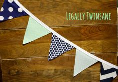 Navy and mint bunting - see more on http://themerrybride.org/2014/05/22/mint-and-navy-wedding/