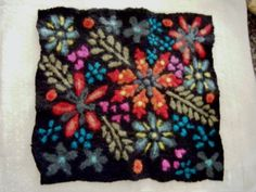 Needle felted picture with machine embroidery and bead embellishments
