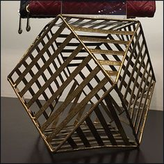 Given all the cross members it is difficult to determine just how many sides this fixture has, so suffice it to say a Henri Bendel Geodesic Purse Pedestal. Retail Merchandising, Henri Bendel, My Happy Place, Pedestal, Plush, Purses, Home Decor, Handbags, Homemade Home Decor
