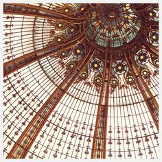 Irene Suchocki—a view from below of an elaborately domed stain glass window.