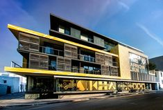 SAOTA Architects, Antoni Associates and OKHA Interiors and Design wrap their building in bold yellow graphics, Cape Town, South Africa