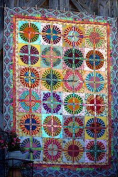 Sari Bari Quilt Wagon Wheels | eBay - Made by a friend of mine for Sari Bari! No bids yet, so you could take this baby home!
