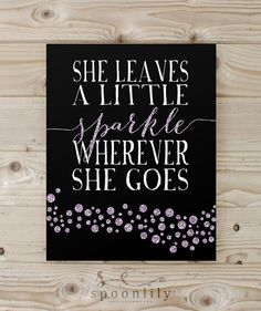 She Leaves a Little Sparkle Wherever She Goes typography quote with digital purple sparkles. SpoonLily also carries this art print with pink sparkles.