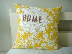 Simple doily pillow.  Would use a different color to match our decor, but such a cute idea!