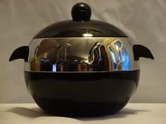 Vintage black and chrome penguin ice bucket. I've only seen them before in all-chrome.