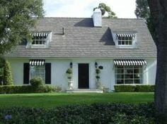 white house with black and white canopy  - mylusciouslife.com.jpg