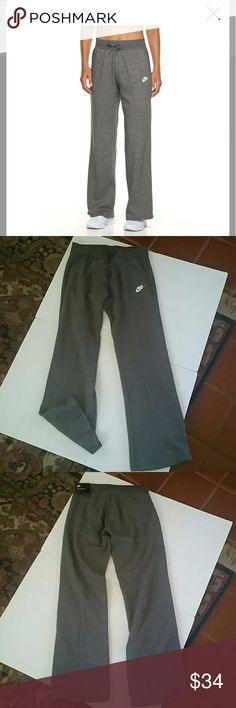 Women's Nike Fleece Pants PRODUCT FEATURES: Nike logo with Swoosh Open hem  FIT & SIZING: 32-in. approx. inseam Midrise sits above the hip Drawcord elastic waistband  FABRIC & CARE: Cotton, rayon, polyester Machine wash  *Retails for $50, Price is firm Nike Pants