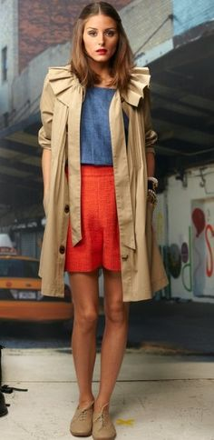 Play up your spring wardrobe and channel Olivia's colorful look with a pair of high-wasited, brightly colored trouser shorts. Add a chambray top like Olivia's for a pretty color contrast, and finish off with some brogues and a tan jacket.