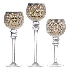 Mixing hues of silver and gold with a delightful honeycomb body, these Silver and Gold Mercury Glass Charismas delight with their rich, metallic colors. Lantern Candle Holders, Doll Stands, Mercury Glass, Metallic Colors, Honeycomb, Wine Glass, Decorative Pillows, Container, Candles