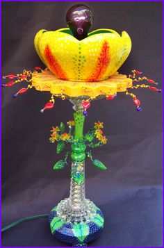 Kimberly Arden. Found object/polymer art. I used a vintage black light bulb in this.