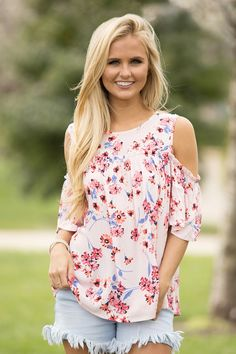 This beautiful floral blouse is such a gorgeous look for spring! Featuring a lovely combination of light pink, orange, black, coral, white, dark pink, and light blue, this blouse has such a romantic a
