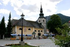 According to tradition the church was built in the very earliest days of Kranjska Gora's history. It was built in honour of the Virgin Mary and was called the church of Mary at Beli prod. Only the bell tower, built from sandy blocks in Romanesque style remains from the original church.