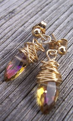 I like this because it looks like dance shoes.     Yellow mystic citrine and gold wire wrapped earrings