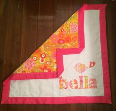 Baby quilt for Bella with name and birdie.