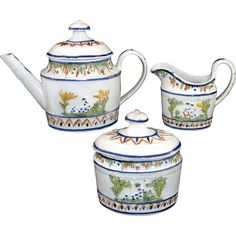 Extremely Rare Miniature Pratt Relief Decorated Pearlware Tea Set c1800  straight-spouted lidded teapot standing 4-1/4 inches tall; a covered sugar box standing 3-1/2 inches tall, and a cream pitcher or milk jug, standing 2-3/4 inches tall. The set has a relief decorated body and half ball finials on the lids. Molded acanthus leaves and a floral motif with sprigged central images of 'Poor Maria' (with dog) and 'Mother & Child