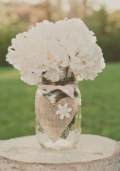 rustic burlap wedding centerpiece  / http://www.deerpearlflowers.com/rustic-wedding-ideas-with-burlap-touches/2/