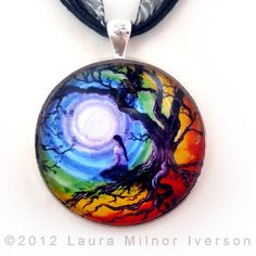 Tree of Life Meditation -- New one in stock (this is my most popular pendant).    A woman sits beneath a tree of life meditating on the chakras, which are swirling around the full moon. She wears a white peasant blouse and blue jeans, her hair tied in a single braid down her back. The tree was inspired by the gnarled old oaks in my native California landscape. The joyful chakras have a nod to the colorful tie dye art of the hippie era.